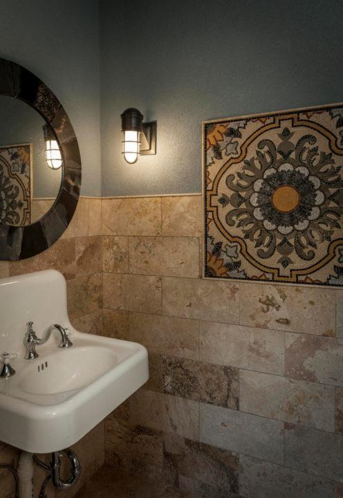travertine tile, inset mosaic pattern, Italian mosaic tile, floral mosaic tile pattern, pencil mold trim, tile on walls, pool bath, repurposed antique sink, wall hung sink