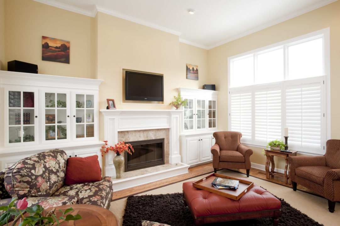 fireplace surround, marble fireplace hearth, custom mantle, glass front white painted book cases with storage