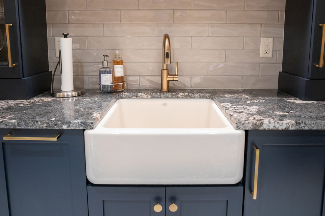 granite countertops, shaker style cabinets, farmhouse sink