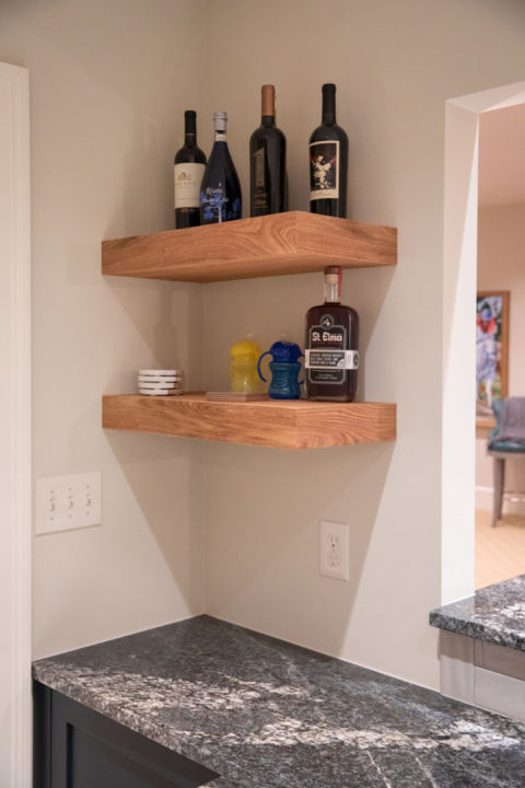 granite countertops, floating wood shelves