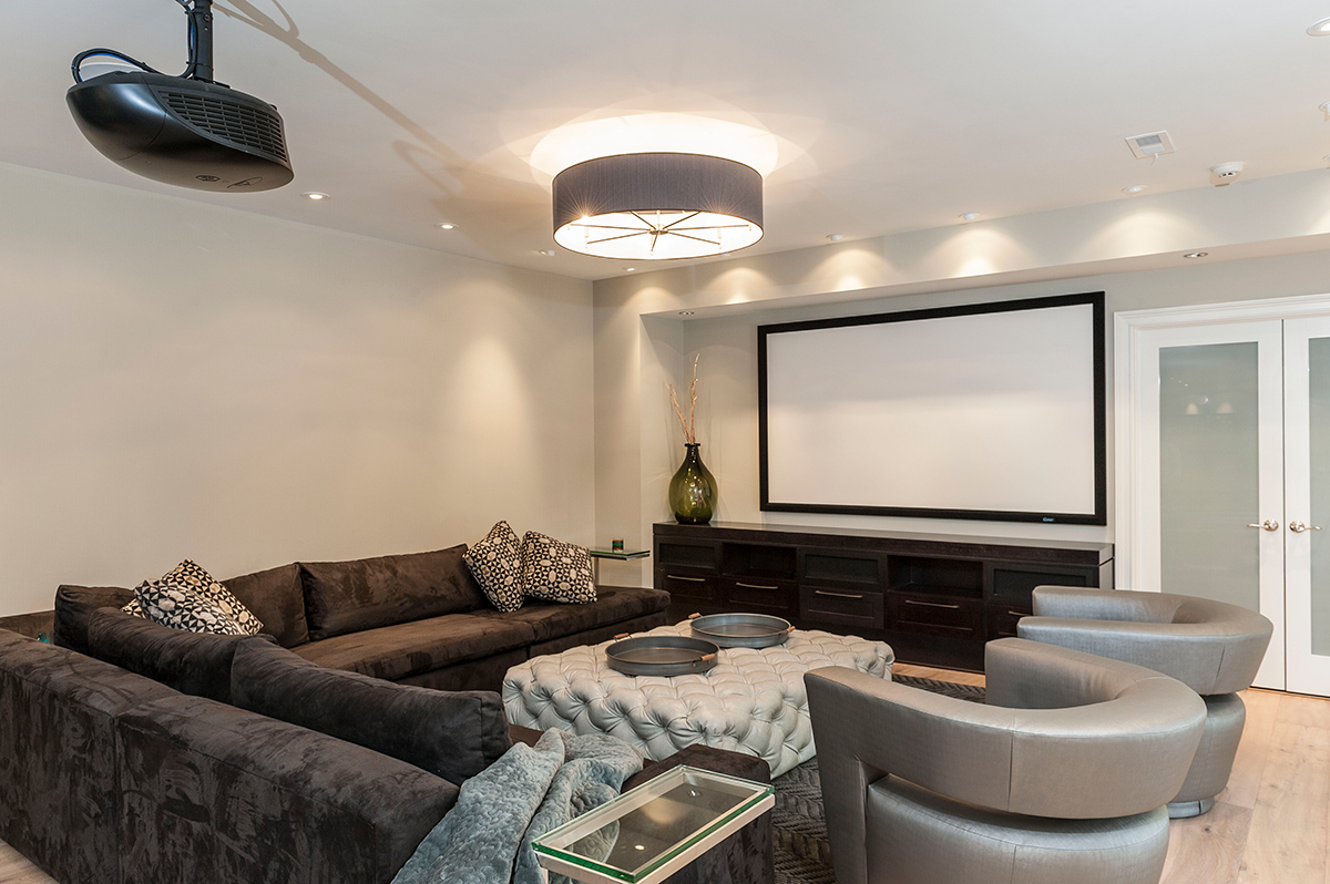 basement lounge area, projection tv, seating and storage