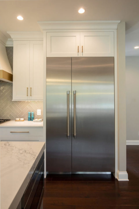 open concept entertaining, open floorplan, open kitchen and dining, custom white maple cabinetry, satin brass cabinet hardware, white quartz countertop, mitered edge, stainless appliances