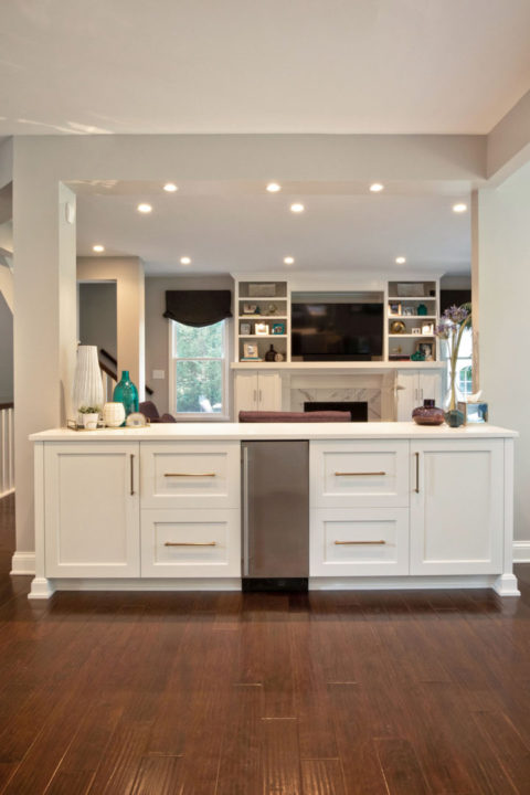 open concept entertaining, open floorplan, open kitchen and dining, custom white maple cabinetry, satin brass cabinet hardware, serving buffet