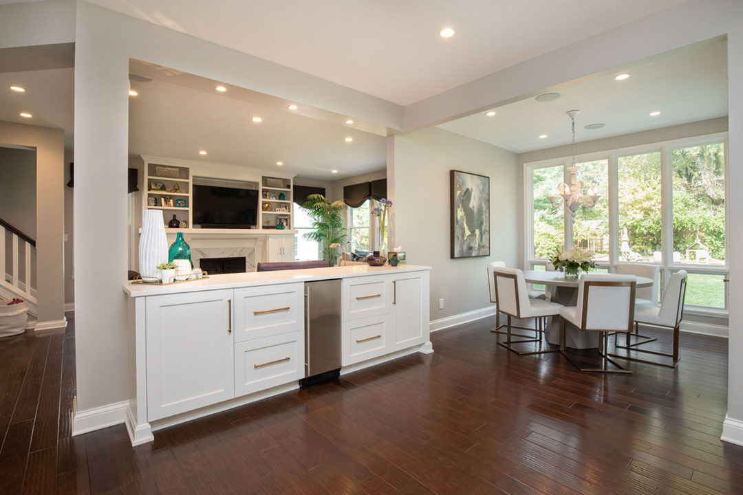 open concept entertaining, open floorplan, open kitchen and dining, custom white maple cabinetry, satin brass cabinet hardware, tile surround, serving buffet