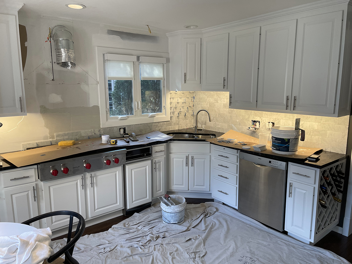 white kitchen with wolfe range