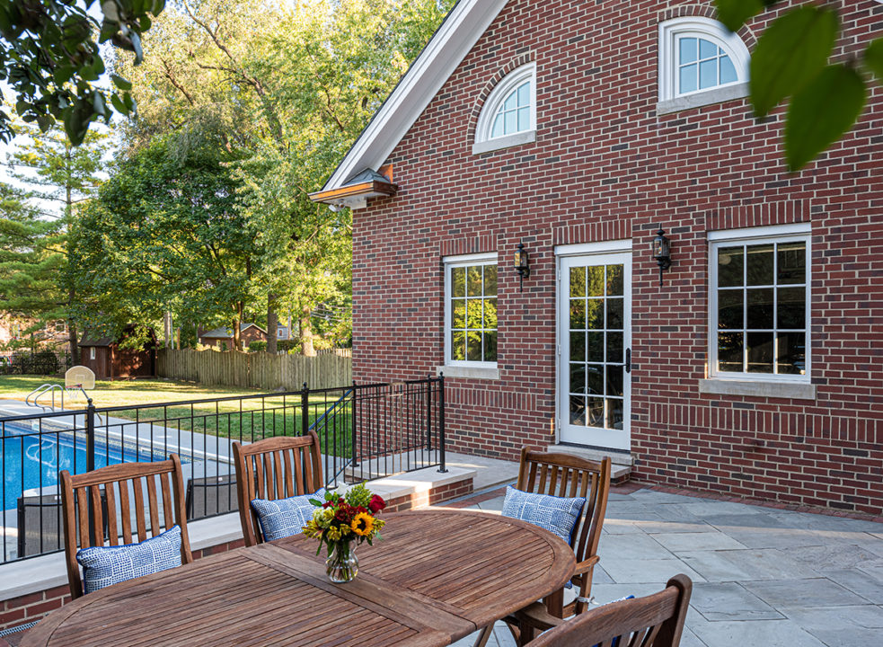 slate roof, carriage house garage, copper gutters, limestone step, limestone stoop, back entry, wrought iron handrail, seating area, patio, patio seating