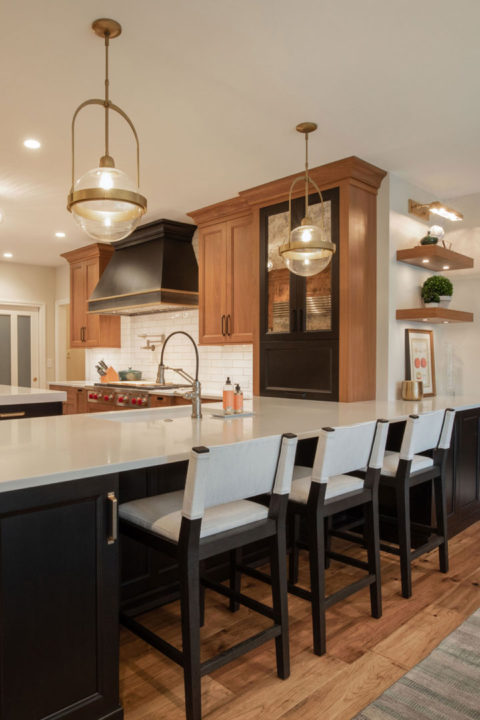 open concept kitchen, black and walnut kitchen, mixing stained and painted woods, kitchen of stained and painted wood, medium wood hardwoods, large sophisticated kitchen, entertainers space, transitional living spaces, transitional kitchen