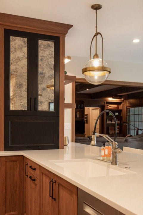 open concept kitchen, black and walnut kitchen, mixing stained and painted woods, kitchen of stained and painted wood, medium wood hardwoods, large sophisticated kitchen, entertainers space, transitional living spaces, transitional kitchen, aged glass door fronts