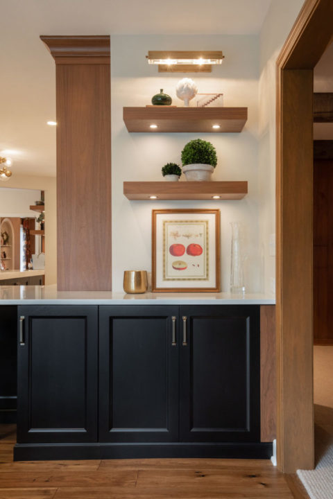 open concept kitchen, black and walnut kitchen, mixing stained and painted woods, kitchen of stained and painted wood, medium wood hardwoods, large sophisticated kitchen, entertainers space, transitional living spaces, transitional kitchen, floating shelves
