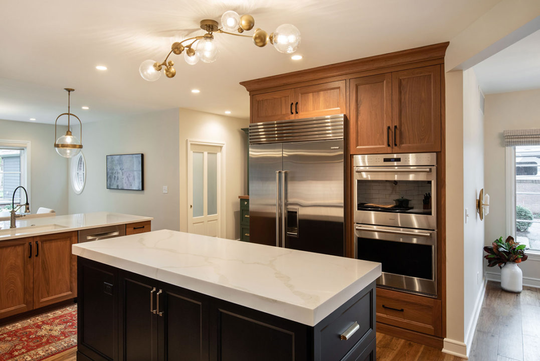 open concept kitchen, black and walnut kitchen, mixing stained and painted woods, kitchen of stained and painted wood, medium wood hardwoods, large sophisticated kitchen, entertainers space, transitional living spaces, transitional kitchen, island with storage