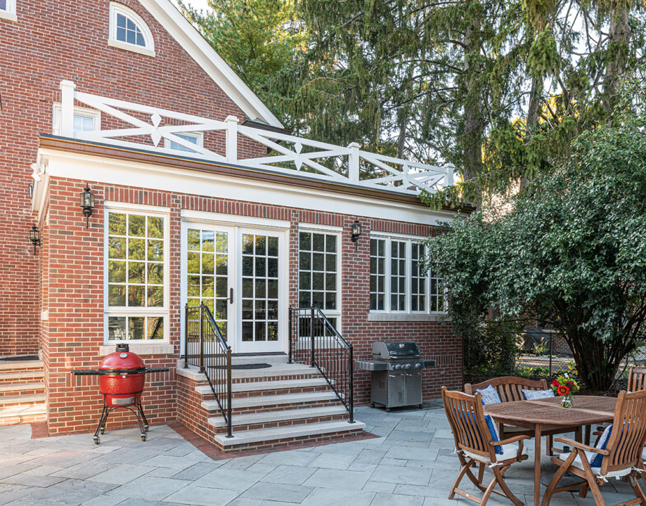 sunroom, limestone step, limestone stoop, back entry, wrought iron handrail, grilling center, seating area, patio, patio seating