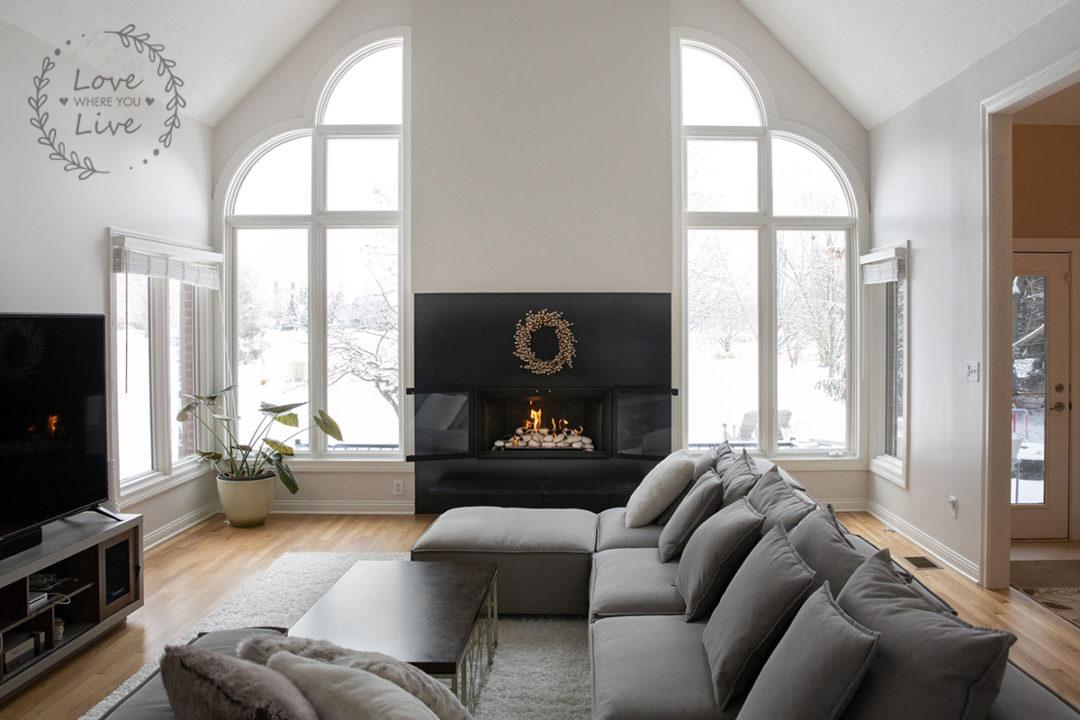 clean lines, sleek and simple, fresh white, floating hearth granite fireplace, steel slab surround, chandelier, oak hardwood floors