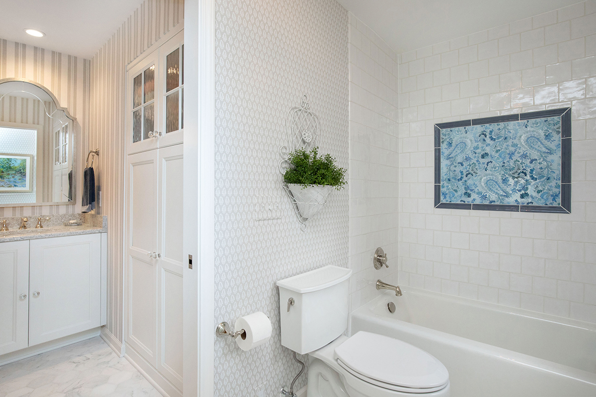 Elegant master bathroom, sophisticated master bathroom, vanity in one room with tub and shower in separate room, white and gray bathroom, guest bathroom, white and blue bathroom
