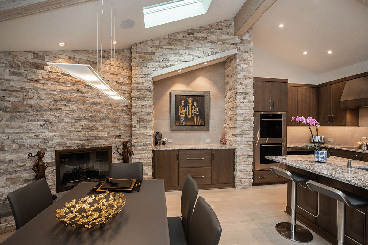 vaulted ceiling in kitchen, skylights in kitchen, dining area in kitchen, fireplace in kitchen, sliding doors in kitchen, kitchen to patio, angled area over buffet area, unique buffet areas, wood beams in kitchen, wood beams, kitchen buffet