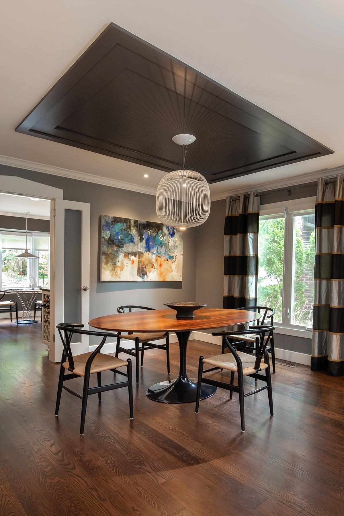 dining area, multi layered paneled ceiling, upgraded lighting, art lighting