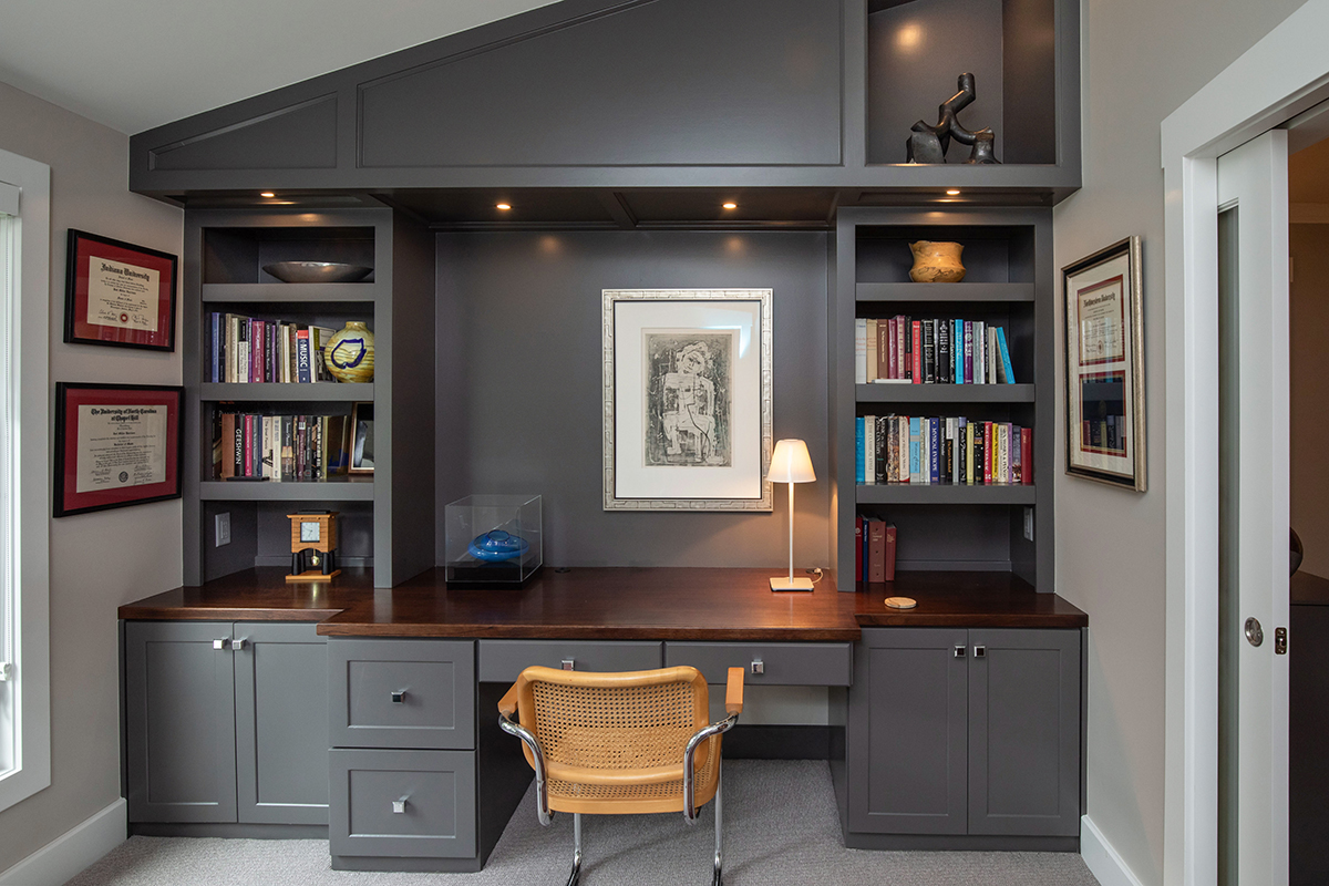 screened in porch becomes office and exercise room, office opens to bedroom, porch to office, custom desk and built-ins