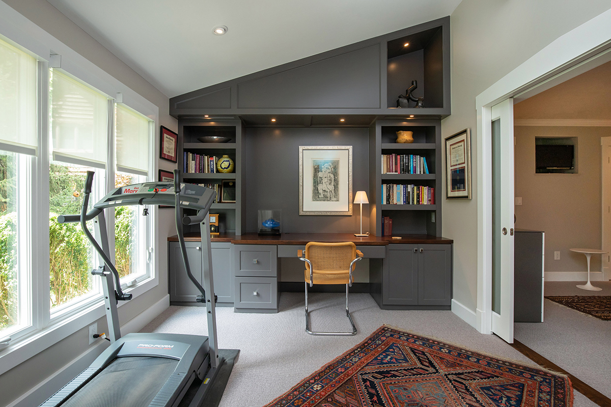 screened in porch becomes office and exercise room, office opens to bedroom, porch to office, custom desk and built-ins. frosted glass pocket doors to bedroom